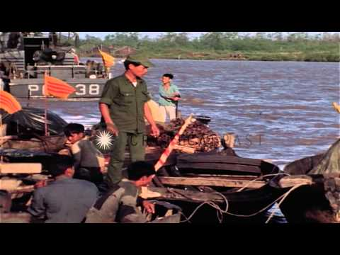 Vietnamese aboard sampans approach a barge complex on the Cua Lon River during Op...HD Stock Footage