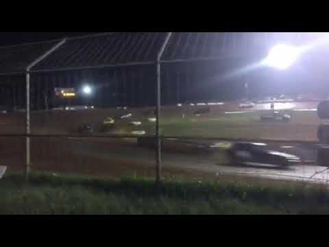 Bmw race car racing on dirt at talladega short track