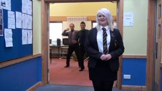 honiton community college teachers dancing behind students