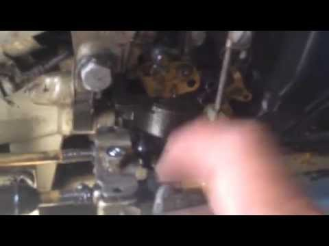 55 Evinrude adjusting throttle cable from engine and run in water