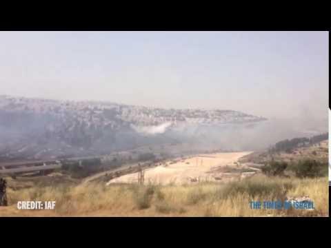 Israeli Air Force planes dump water on Jerusalem fires