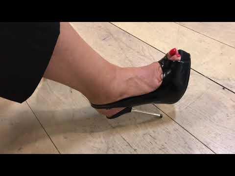 Metal heels on wooden floor