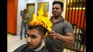 Brave customers let barber cut their hair with fire! :D