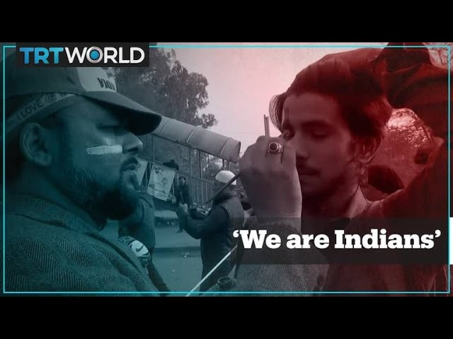 Muslims in India paint flags on their faces in a show of identity