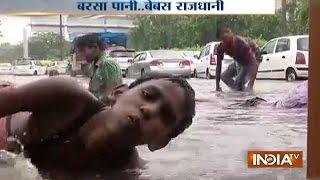 Heavy Rain Brings Temperature Down but Causes Water-logging in Delhi