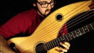 Travis Bowman - Hotel California (Eagles) - (Fingerstyle Harp Guitar)