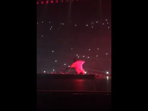 69e1981cc393 Travis Scott falls off into a pit whilst on stage at a Drake concert ...