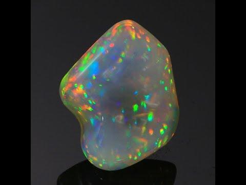 37.30 Carats Freeform Carved Welo Opal Gemstone