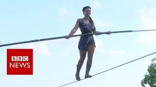 French woman in Montmartre tightrope walk - BBC News