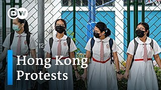 Over 1,300 people detained in Hong Kong protests | DW News