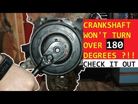 CRANKSHAFT WON'T TURN OVER 180 DEGREES. ENGINE OUT OF TIMING.
