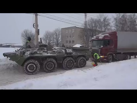 BTR-80 APC rescues truck stuck in snow in Russia