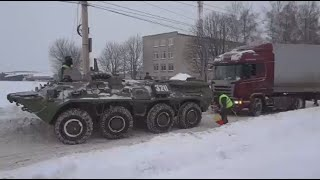 BTR-80 APC rescues truck stuck in snow in Russia