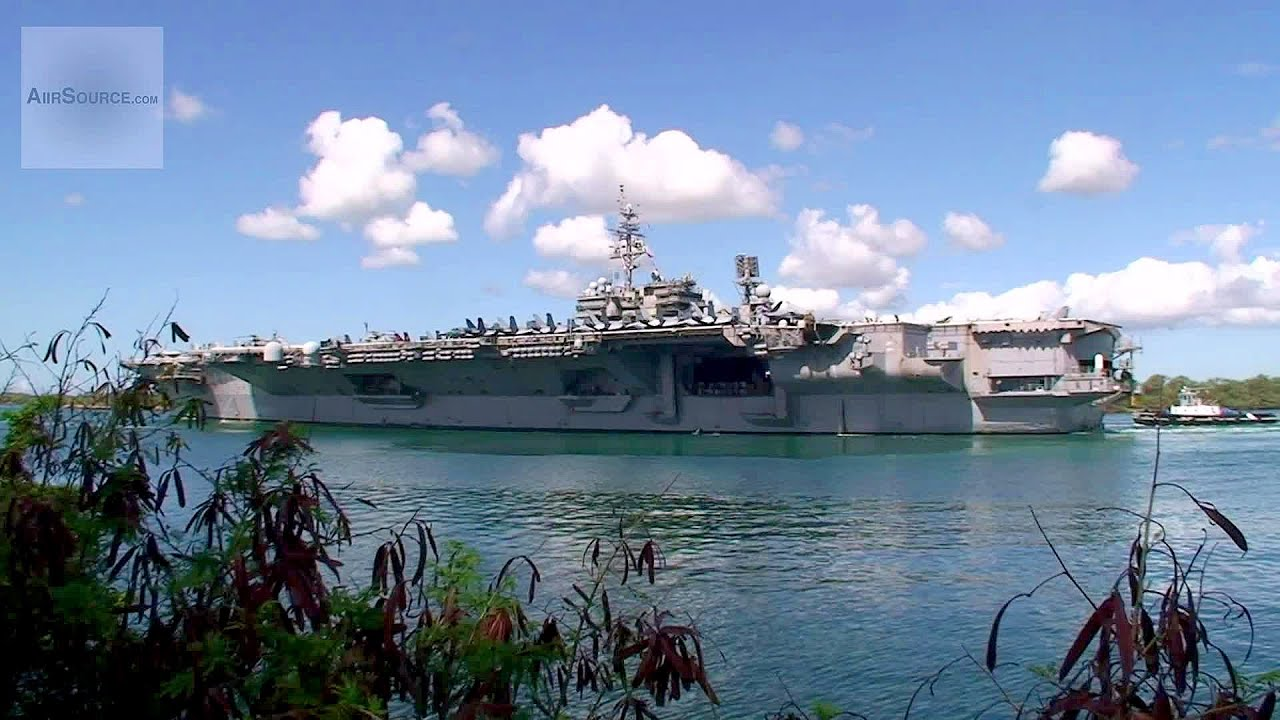 uss kitty hawk aircraft carrier departing pearl harbor