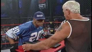 Bullet Bob vs Konnan In an Arm Wrestling match at Lockdown 2006