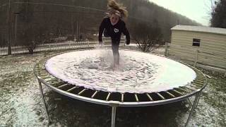 Slow motion Trampoline jump in the snow