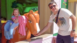 Nastya and dad play in the amusement park - Vlog