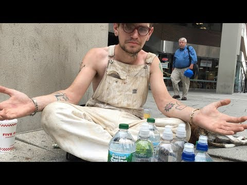 People keep giving this homeless man water even with 9 bottles of water in front of him
