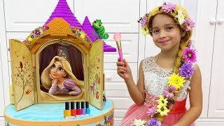 Sofia as Rapunzel plays in a beauty salon in her Princess Room
