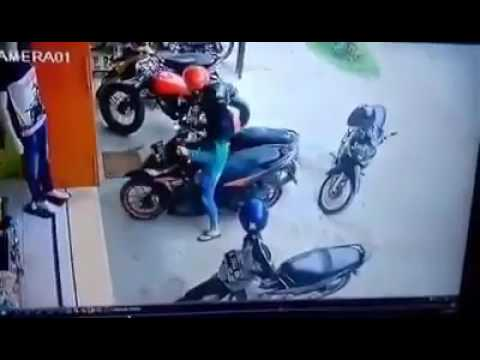 Woman scooter parking funny