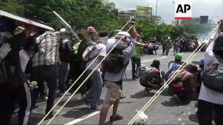 Protesters clash with police in Caracas