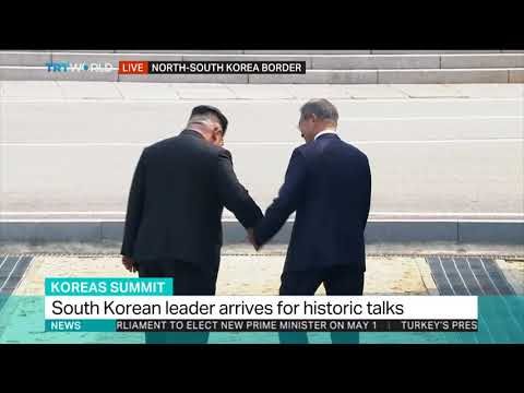 North Korea's Kim steps into South for historic summit