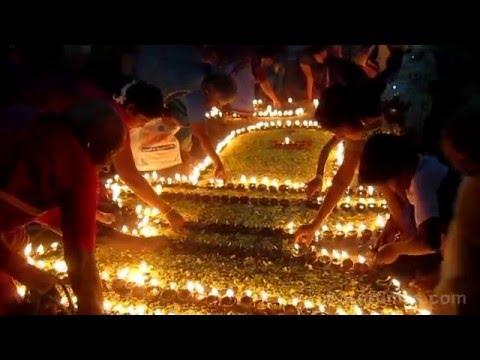 Lighted earthen lamps (Agal Vilakku) depiction the Siva Lingam