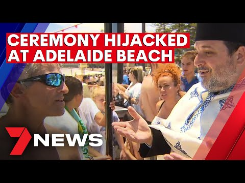 Beachside chaos as Greek Blessing of the Waters 'hijacked' by unregistered diver in Adelaide | 7NEWS