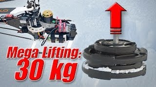 RC helicopter weight lifting record 30kg/66 lbs - record heavy lifter Top 10 Video