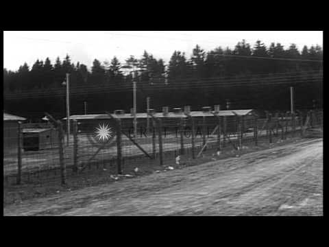 Partially burned bodies of prisoners removed from a barrack at Stalag 4 Concentra...HD Stock Footage