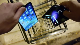 Download Dropping Samsung Galaxy Fold vs iPhone 11 Pro Max vs Nokia 3310 Down Spiral Staircase - 20 Stories Mp3 and Videos