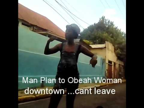man plan to obeah woman ( use Science ) downtown so she cant leave him