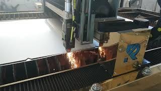 Лазерная резка стали. Работа лазерного станка. Производство станков лазерной резки.