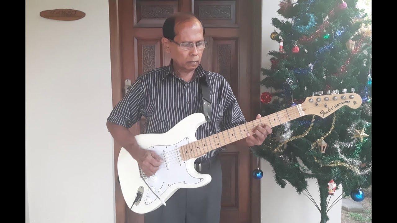 Download Long Time Ago in Bethlehem (Mary's Boy Child)/කලකට පෙර - Guitar Instrumental by Oswald De Silva