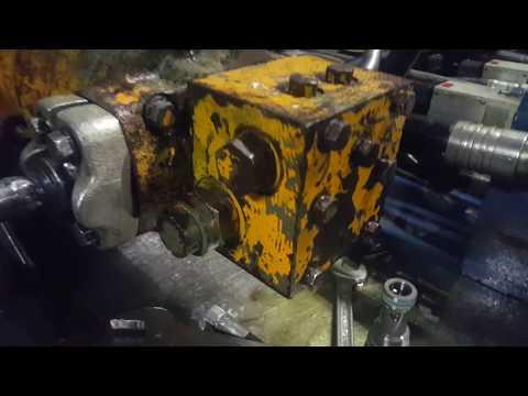 Предохранительный клапан гидронасоса.