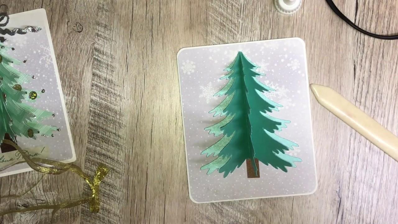 Раскрытая открытка в ней елка