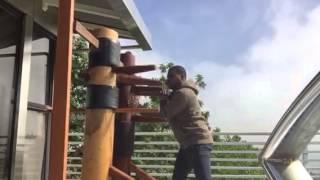 Rahsun working on his Wooden dummies #twoWoodenDummiesAtTheSameDamnTime