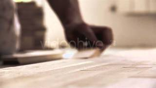 Stock Footage - Carpenter Worker Installing Parquet | Videohive
