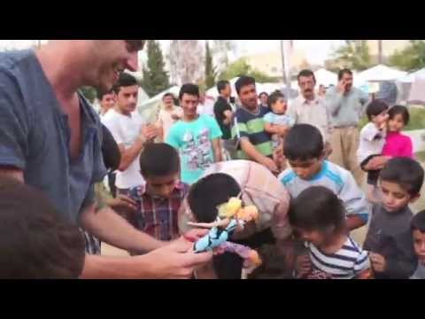 Delivering toys to children in an Iraq refugee camp