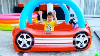 Katy and Max play with inflatable toy house