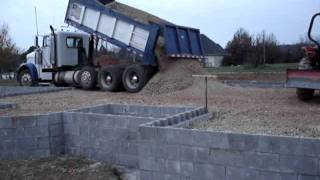 Foundation Building - Dump Truck Dumping Gravel our House