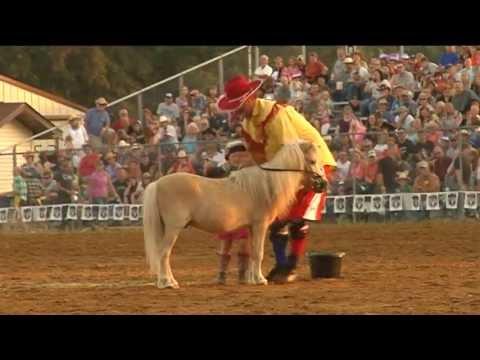 Spooner Rodeo Clown John Harrison And His Daughter Falling