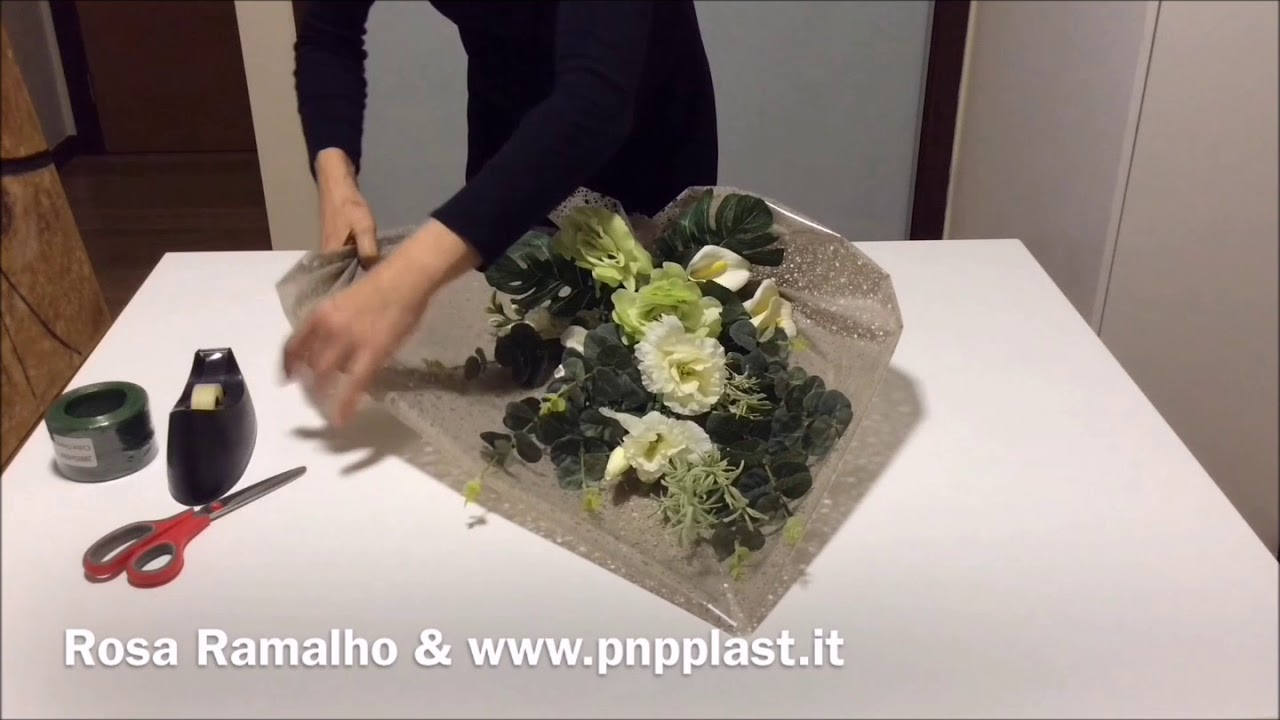 Wrapping flowers with cellophane - YouTube