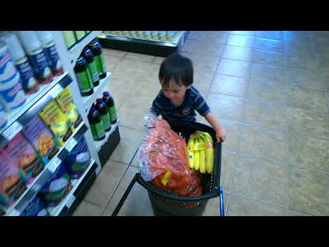 Almost two years old shopping at a goodness me health store