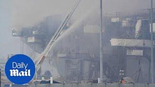 San Diego fire crews battle blaze aboard USS Bonhomme Richard for second day