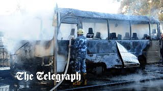 Many killed as roadside bombs hit bus in Damascus