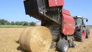 straw baling with fendt 716 and case ih round baler
