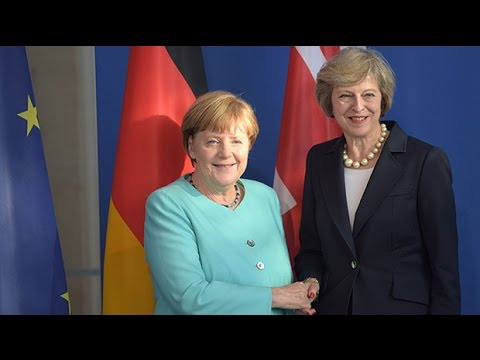 Theresa May and Angela Merkel's friendly first meeting
