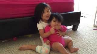 Toddler sings to baby sister