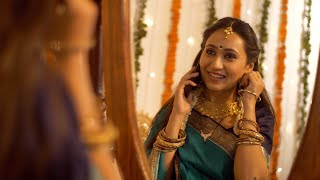 Well-dressed South-Indian woman inviting her friends to celebrate Diwali festival over a phone call